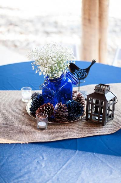 This lovely centerpiece with simple found objects like mason jars, laterns and re-purposed pine cones is truly one-of-a-kind!