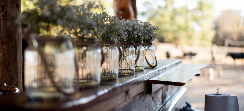 Find inspiration for your own wedding or corporate event with everyday items like mason jars filled with baby's breath!